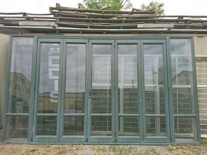 Karaka green aluminium five leaf bi-fold door