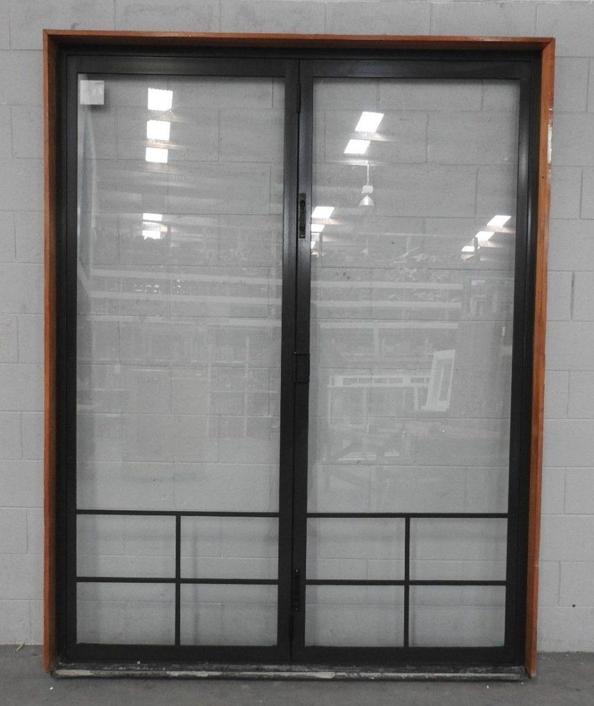Tall Karaka green aluminium bi-fold door