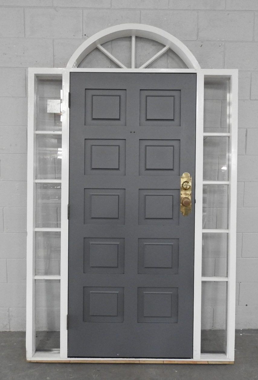 Wooden exterior entry door with sidelights and toplight
